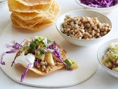 Fish and White Bean Tostadas : The key to making this fish dinner on the cheap is stretching it with beans. Pile fried, crispy corn tortillas high with lime-marinated tilapia, sauteed white beans and all the fixings. Plus, Melissa opts for a surprising ingredient, canned pineapple, to get that chunky pineapple taste without shelling out the money for fresh.