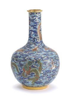 A GILT-BRONZE AND CLOISONNÉ-ENAMEL 'DRAGON' BOTTLE VASE, TIANQIUPING QING DYNASTY, QIANLONG PERIOD of globular form rising from a tapered foot to a slender neck and flanged rim, decorated around the body with a red and a green five-clawed dragon vying for a 'flaming pearl', writhing among billowing clouds enamelled in shades of blue, all against a bright turquoise ground