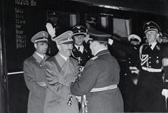 Hitler effusively greeting an ornately decked-out Goering (who even has his baton and sword with him). A moody Hess lurks behind.