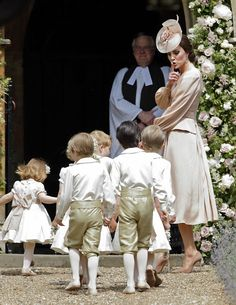 The Duchess of Cambridge tells the little ones to keep the noise down as the page boys and bridesmaids make their way into the church