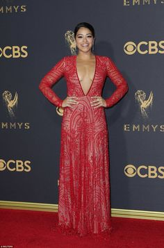 Plunging: Jane The Virgin star Gina Rodriguez stunned in her revealing red dress with sheer sleeves and a deep-v neckline