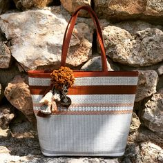 "Sumaqkay ""Rebecca"" handbag : luxury handbags & accessories, made with handwoven fabrics by artisans from Paracas, Peru. Each bag is unique and is inspired by Nazca, Paracas and Wari cultures, known for its exquisite textile art. Sumaqkay combine traditional weaving techniques with pre-columbine and modern design to create the most original contemporary pieces."