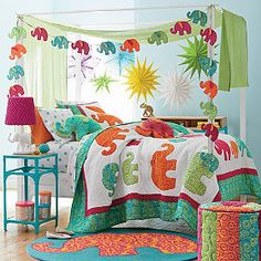 Like the elephant bunting...may make one in solids coordinating with the elephant print.
