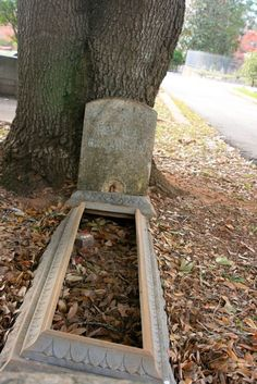 The usual meaning of this type of open grave cover is that it is a child that is buried  beneath. Memory Hill Cemetery in Milledgeville, Georgia. Photo by Amy Laurel Hegy @A Tale of Two Tramps