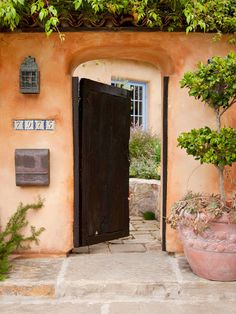 We love this old-world-inspired entry! More front entry lighting and accessories: http://www.bhg.com/home-improvement/door/exterior/front-door-lighting-and-accessories/?socsrc=bhgpin081213woodgate=9