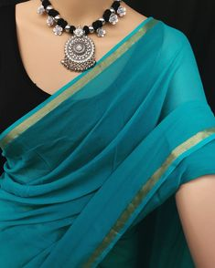 "Chiffon blue saree with golden border. 45"" height.  5.5 meters saree. Saree alone. Dry clean . Price"