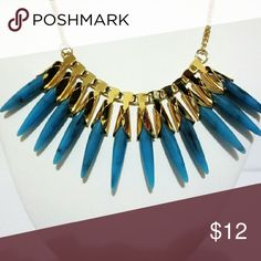 Mudd Gold and Turquoise Spike Necklace This stunning spike turquoise necklace by Mudd is sure to make you stand out amongst the crowd. Mudd Jewelry Necklaces