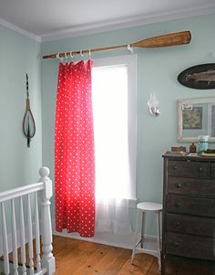 Love the red and roi\obins egg blue together and the oar - adorable for a lake house.