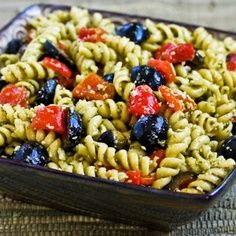 pesto pasta salad for lunches--black olives, tomatoes, fresh basil, chicken, cheese