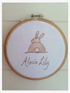 Custom Hand Stitched Name Embroidery Sign with Bunny Rabbit in Wooden Hoop Wall Art Print for Child or Nursery Room. $25.00, via Etsy.