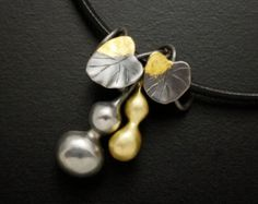 Green tourmaline hematite fan motif silver pendant by KAZNESQ