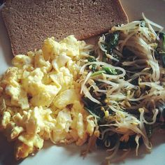 Low-fat scrambled eggs (1yolk+2whites) w/ rye bread. Soya sprouts & baby spinach as a side. - @melissazino- #webstagram