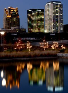Downtown buildings are reflected in a lake at Railroad Park in Birmingham, Alabama, 12/18/12.
