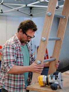 Make your own rustic wooden ladder from 2x4s and iron pipe with end caps! How genius is this!? Thanks HGTV