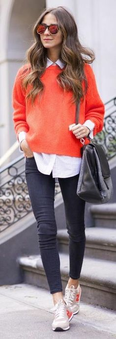 She nailed it without even trying. Oversized striped button down shirt underneath a shorter loose fitting orange sweater. Ankle grazer leggings and neutral New Balance sneakers with orange logo, keyed to the sweater. Oversized bag, sunnies. Style Planet