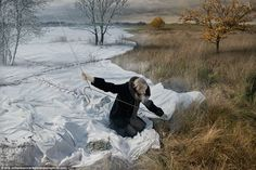 In Mr Johansson's image Expecting Winter, a woman is photographed sewing together blankets of snow across an autumn landscape