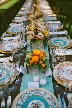 A turquoise runner with potted centerpieces enhances the dinner plates. Source: Caroline Ghetes #tablerunners #turquoise