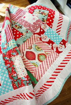 gorgeous Christmas quilt by nanacompany. Love the blue binding and candy cane stripe along the outside