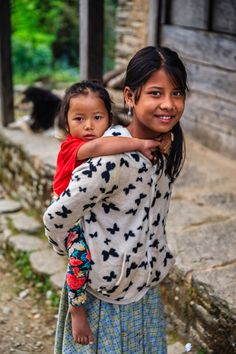 Nepali queen girl whatsapp number for chat friendship girl whatsapp nepali girl carrying her little sister village in annapurna conservation area ccuart Gallery