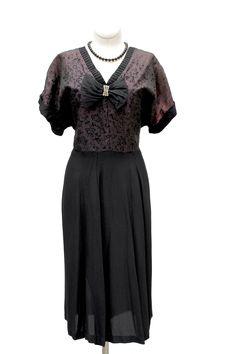 Cabaret Vintage - 1950s Black Cocktail Dress with Sparkle and Bow, $125.00 (http://www.cabaretvintage.com/new-arrivals/1950s-black-cocktail-dress-with-sparkle-and-bow/)