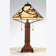 The Grove Park table lamp from Quoizel features a wood and iron combination base, with a beautiful branch and blossom pattern on the shade. It would be lovely in your Asian-inspired or Arts and Crafts style home.