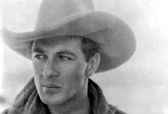 This is indeed a photo of Gary Cooper.  However, it is not from the film 'Mr. Deeds Goes to Town' (which was not a western in any case).  This still is from the film 'The Winning Of Barbara Worth', a 1926 silent film starring Ronald Colman, with Coop in a large supporting role.  Happily, this film has survived in good quality - check it out!