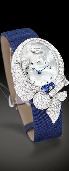 BREGUET - Les Volants De La Reine.2014 http://www.thesterlingsilver.com/product/ls0236841-ladies-gold-plated-and-black-leather-strap-rotary-watch/