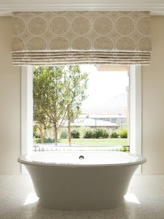 Classic roman shade, outside mount, provides total privacy in this bathroom