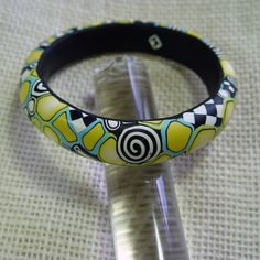 OOAK Polymer Clay Abstract Bangle - Etsy seller blossomstreetstudio   interesting color and pattern combination
