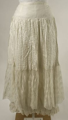 White cotton and lace ruffled petticoat (front), American, ca. 1880. Worn with matching white cotton and lace tea gown.