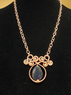 Lapis and Crystal Swirl Pendant - Copper Wire Jewelers
