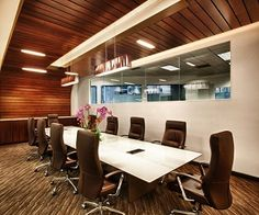 The rich brown motif extends into the boardroom floors and chairs, the building's exterior and the wood ceiling that winds its way down the corridor and ties together all of the rooms.
