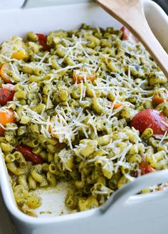 This BAKED PESTO MACARONI is tossed with heirloom tomatoes and a saucy spinach pesto that will knock your socks off! 340 calories.