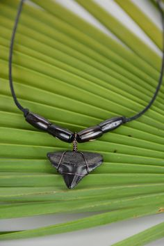 Megalodon Shark Tooth Necklace by JustBeadHappy2 on Etsy https://www.etsy.com/listing/214316181/megalodon-shark-tooth-necklace
