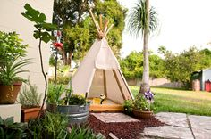 DIY Teepee Sandbox.  this is just what I need to keep the sun off the kids