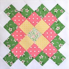 This is a Great Granny Square block.  The green border fabric is one of my all-time favorites.