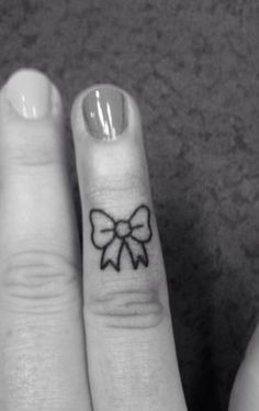 Finger bow tattoo add heart in center great wedding ring finger tatt
