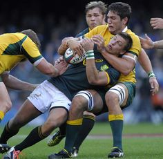 South Africa's Handre Pollard is halted by the Australian defence