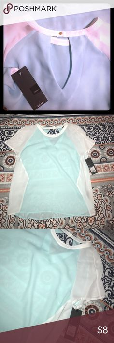 Sea foam green blouse Sea foam green with white blouse. Shear material. Button in the back with cute cut out. New with tags. Mossimo Supply Co Tops Blouses