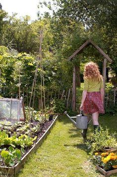 Gratuitous farm girl pic. Love the entry way/trellis and the gardens.
