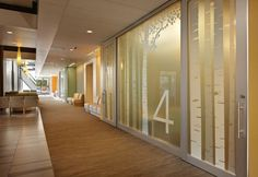 An east-west corridor at The Everett Clinic's Smokey Point Medical Center leads to the clinic pods, which are identified using subtle wayfin...