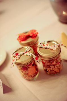 Snack favors in mason jars...fall themed, and nice for our guests when we took way to long getting from the ceremony to the reception.