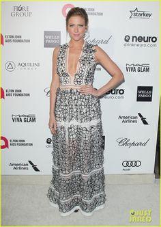 Brittany Snow in a Blumarine dress, Giuseppe Zanotti shoes, ASPIRI jewels, and a Swarovski clutch.