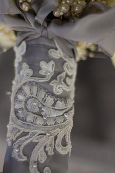 Gorgeous custom wrap for bridal bouquet...lace appliqué over silver satin ribbon.