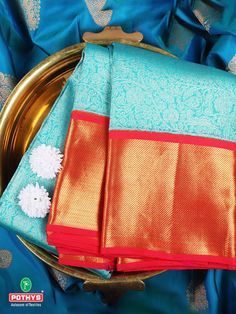 The dual toned light blue and royal red is always on point. What adds in to the grace is the alluring floral design and sublime zari work. Pick this perfect attire and look perfect on all your special days. #WeddingSilk #kanchipuramPattu #sareeBlousedesign #silksaree #weddingsaree