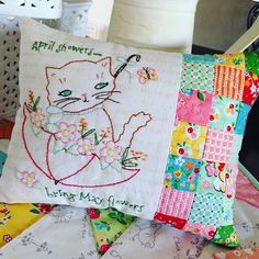 Such a sweet embroidered patchwork pillow made with Nadra Ridgeway's Backyard Roses fabric line #iloverileyblake #fabricismyfun
