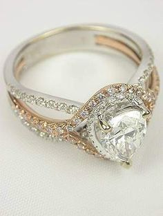 Pear Shaped Diamond Engagement Ring. LOVE the mixed metals.