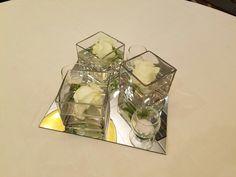 Simple floating rose centerpiece. #artisticbloom #dsmweddings