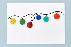 DIY holiday card: Button string lightsDIY holiday card: Button string lights—Create the magic of holiday lights on a card with this cute-as-a-button craft.DIY Christmas Craft Ideas - A Little Craft In Your DayDIY Christmas Craft Diy Holiday Cards, Christmas Card Crafts, Xmas Cards, Button Christmas Cards, Christmas Buttons, Prim Christmas, Handmade Christmas, Christmas Ornaments, Tarjetas Diy