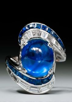 Ashraf Ahamed Ali - Google+ A late 1930's sapphire and diamond ring, centered by a cabochon sapphire weighing approx 9,67 ct., surrounded by calibré cut sapphire and diamond swirls, mounted in platinum.